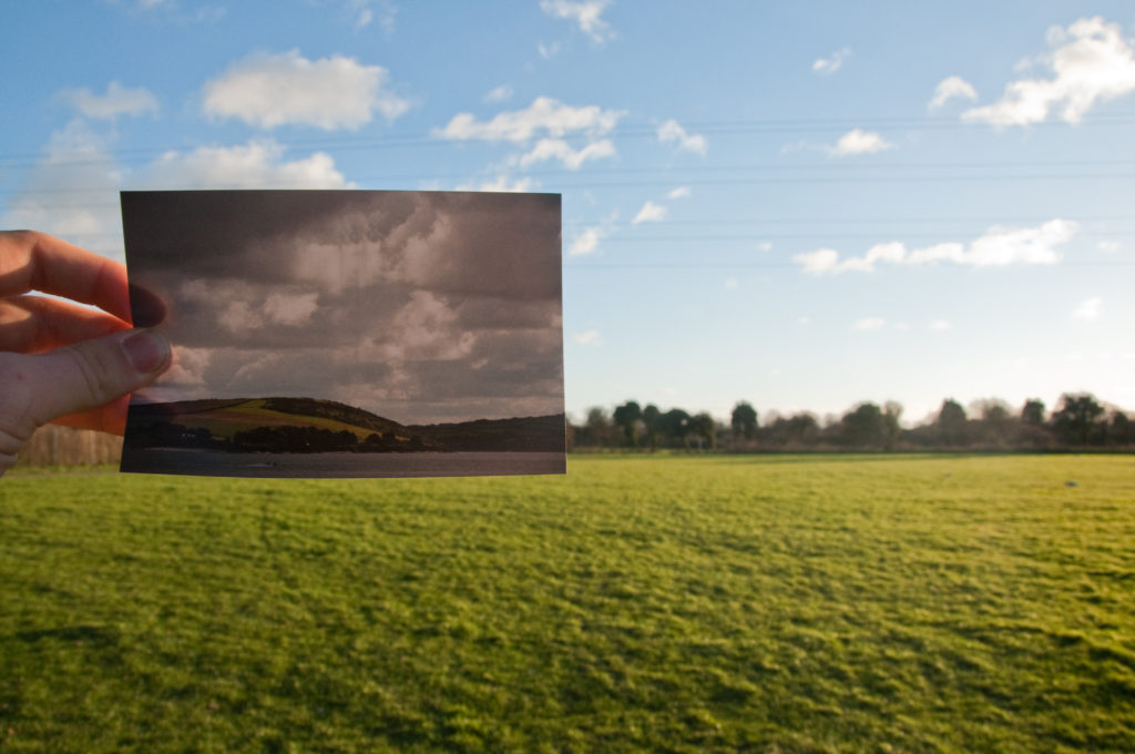 Holding up a photograph - Tips for Studying Photography